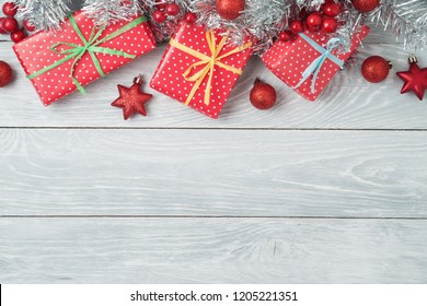 Christmas holiday background with gift boxes and decorations on wooden table. Top view from above