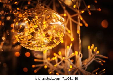 Christmas Holiday Background, glass ball and illuminated garland. Decorarion of kiosk of christmas market in Trento