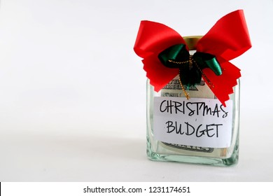 Christmas Holiday Budget- a money saving bottle and grey red  ribbon for christmas purpose, with white background at the left