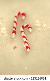 Christmas holiday candy sticks on snowy background