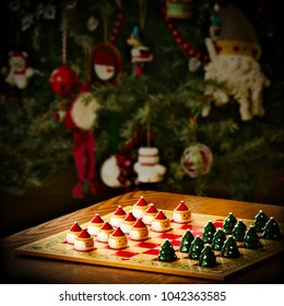 Christmas holiday checker board game set up in front of decorated tree