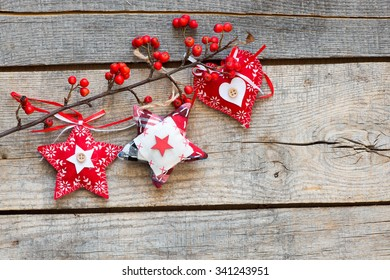 Christmas holiday decorations over wooden background