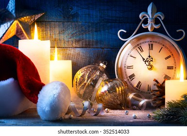 Christmas holiday eve; Christmas decoration and vintage clock