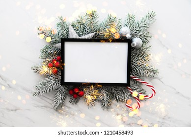 Christmas holiday frame background with xmas tree and xmas decorations. Merry Christmas greeting card, banner. Winter holiday theme. Happy New Year. Space for text