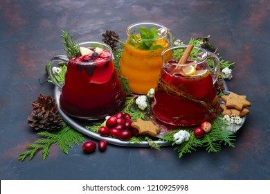 Christmas holiday hot drinks - concept of festive bar menu. Raspberry, orange and cranberry tea.