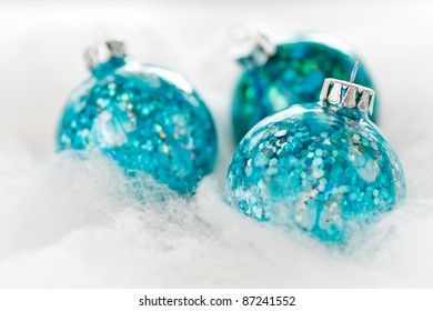 Christmas Holiday ornaments on snow background