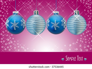 Christmas holiday ornaments with purple background and copyspace for your text