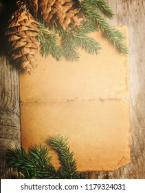 Christmas holiday paper background with fir tree and christmas decoration top view design. Xmas frame for new year wish list letter to santa. Merry Christmas empty card.