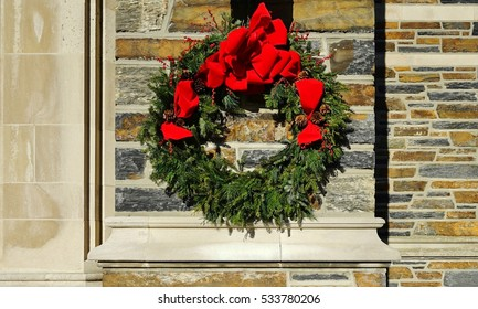 Christmas holiday pine wreath with a red bow