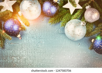 Christmas holiday setting with blue baubles and fir branches. Christmas background with copy space