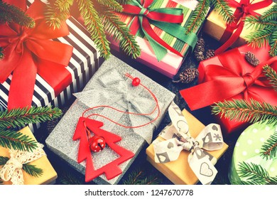 Christmas holiday setting with presents in boxes and festive decoration