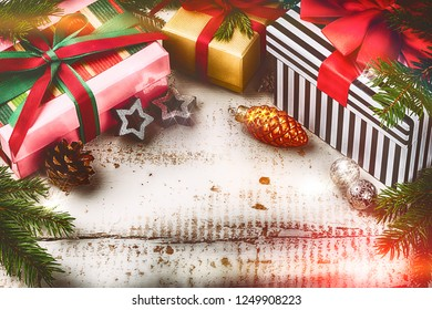 Christmas holiday setting with presents in boxes and festive decorations. Christmas background with copyspace