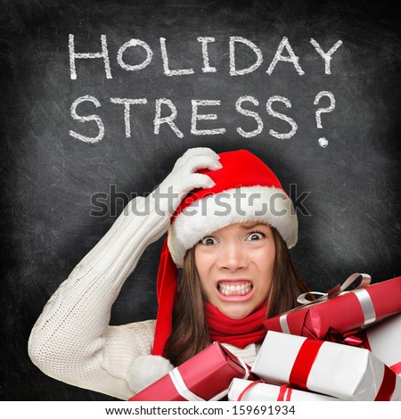 ff6703b83d2e7 Christmas holiday stress. Stressed woman shopping for gifts holding  christmas presents wearing red santa hat