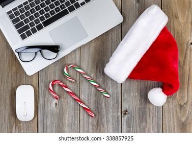 Christmas holiday and technology on rustic desktop. High angled view.