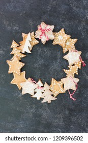 Christmas Holiday wreath flat layout with free copy space. Homemade baked cookies concept.