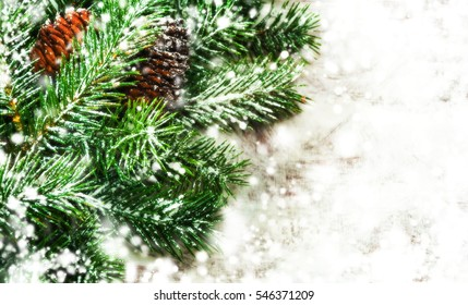 Christmas Holidays Background. Fir Branch With Pine Cone And Snow Flakes