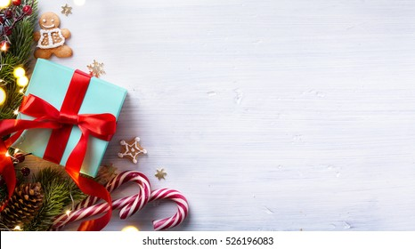 Christmas holidays composition on white wooden background with Christmas tree decoration and copy space for your text