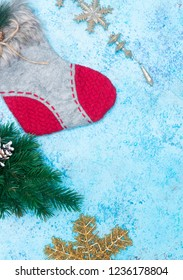 Christmas holidays composition of ornaments on a blue background with copy space for your text. new Year decoration. sock for gifts. snowflake