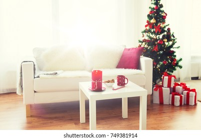 christmas, holidays, winter, home and still life concept - living room interior with christmas tree and gifts