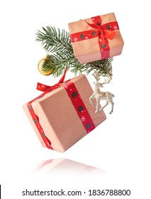 Christmas holliday card. Flying in the air gift boxes on white backround - Shutterstock ID 1836788800