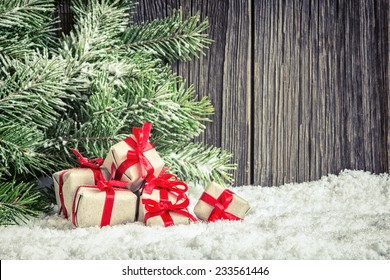 Christmas home decoration with small gifts and spruce branch