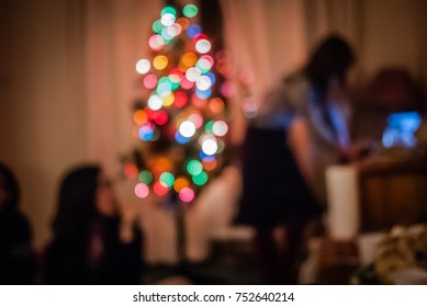 Christmas Home Party with Xmas Tree Light Decorated Looking for Music Playlist on Internet Isolated from Friend. Warm or Sad Melancholy for Introvert Person Not Mixed in Crowd. Winter Night Background