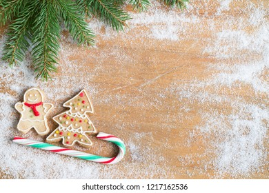 Christmas homemade gingerbread cookies and abstract background with sugar on board