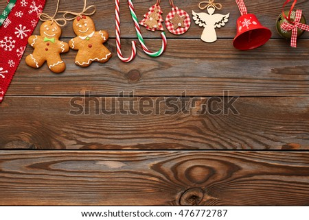 0ab758887f448 Christmas homemade gingerbread cookies and handmade decoration on wooden  background