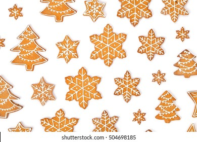 christmas homemade gingerbread cookies isolated on white background top view. snowflake, star, christmas tree shapes. holiday, celebration and cooking concept. new year and christmas postcard