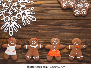 Christmas homemade gingerbread cookies on the wooden background