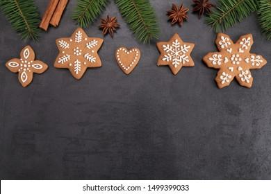 Christmas homemade gingerbread cookies on a dark background. Sweet food.