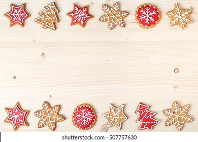 christmas homemade gingerbread cookies on wooden background with copy space for text. snowflake, star, christmas tree shapes. holiday, celebration and cooking concept. new year and christmas frame