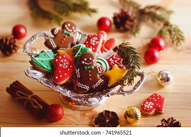 Christmas homemade gingerbread cookies on table in decorated  New Year background