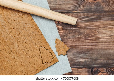 Christmas homemade gingerbread cookies on wooden table top view