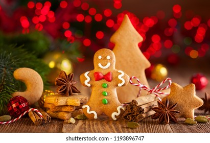Christmas homemade gingerbread cookies and spices on the wooden background