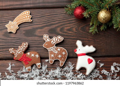 Christmas homemade gingerbread deer over wooden table.Copy space.