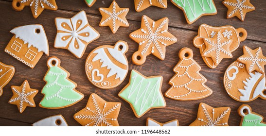 Christmas homemade gingerbread house cookie over wooden background. Sweets as a gift for the new year. free space free space greetings