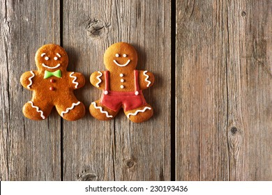 Christmas homemade gingerbread man on wooden table