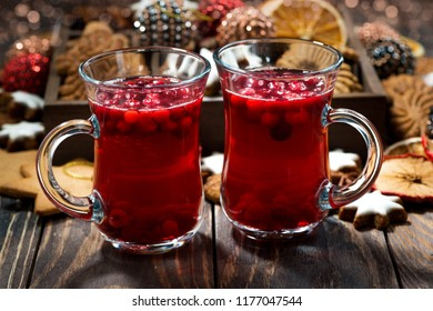 Christmas hot cranberry tea or mulled wine and cookies, closeup