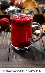 Christmas hot cranberry tea or mulled wine and assorted cookies on dark table, closeup