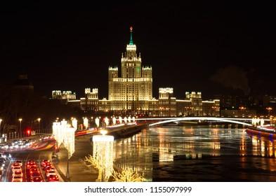 Christmas illumination on Moskvoretskaya embankment. Night view of high-rise building on Kotelnicheskaya embankment, Moscow, Russia