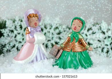 christmas image of two beautiful vintage carol singers