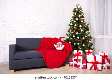 Christmas interior -decorated christmas tree and gift boxes in bright living room