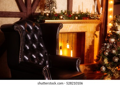Christmas interior with a fireplace armchair, fireplace and mirror. Golden color