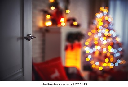Christmas interior with a Christmas tree fireplace and  open door