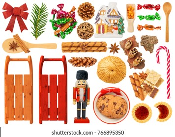 Christmas Items Isolated on White Background. Contains: sledge, nutcracker, wafers, candies, candy cane, wooden spoon, pine cone, star anise, bow, cookies, house,