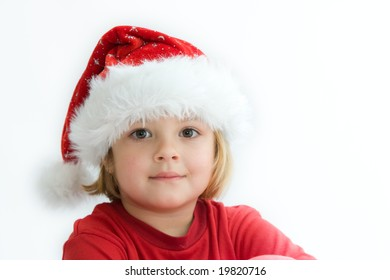 Christmas kid in Santa hat on white background