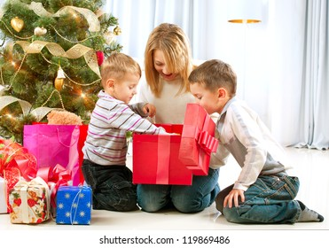 Christmas Kids. Happy Children Opening Gifts. New Year. Christmas Tree
