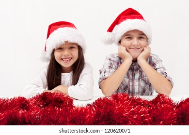 Christmas kids with red garland smiling white baclground