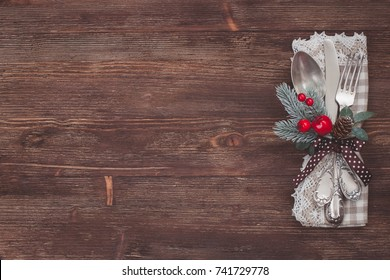 Christmas kitchen towel on the wooden background.